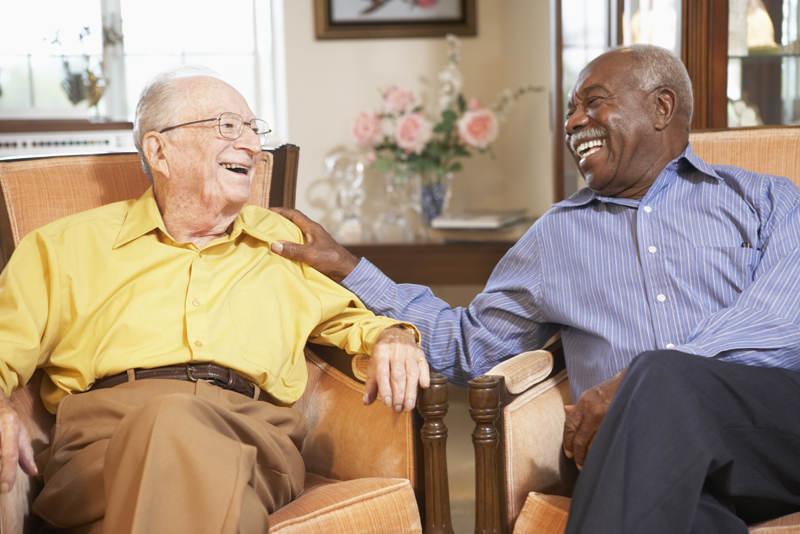 Senior men relaxing in armchairs