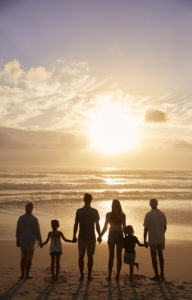 silhouette of multi-generational family on the beach